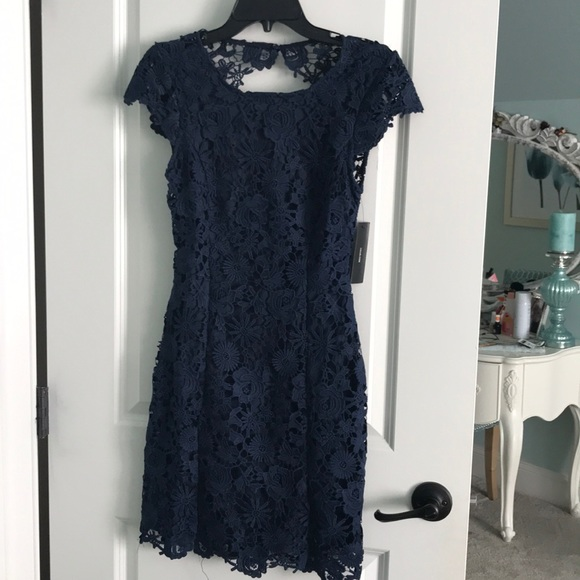 00a47ef8c040 Romance language navy blue backless lace dress. M_5bba406c534ef9f4a8909610
